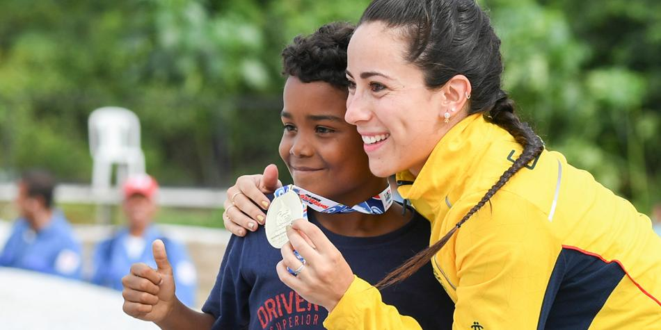 MARIANA PAJÓN UPON THE PODIO: THE OLYMPIC CHAMPION WON THE GOLD MEDAL IN BMX CYCLING IN THE PAN AMERICAN GAMES